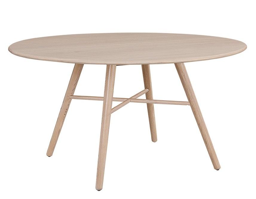 Moderni pyöreä ruokapöytä neljälle hengelle.